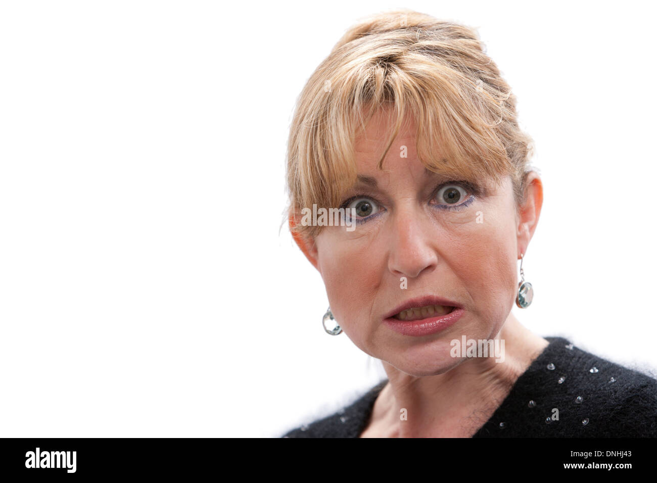 Angry senior woman on white background with room for text - Stock Image