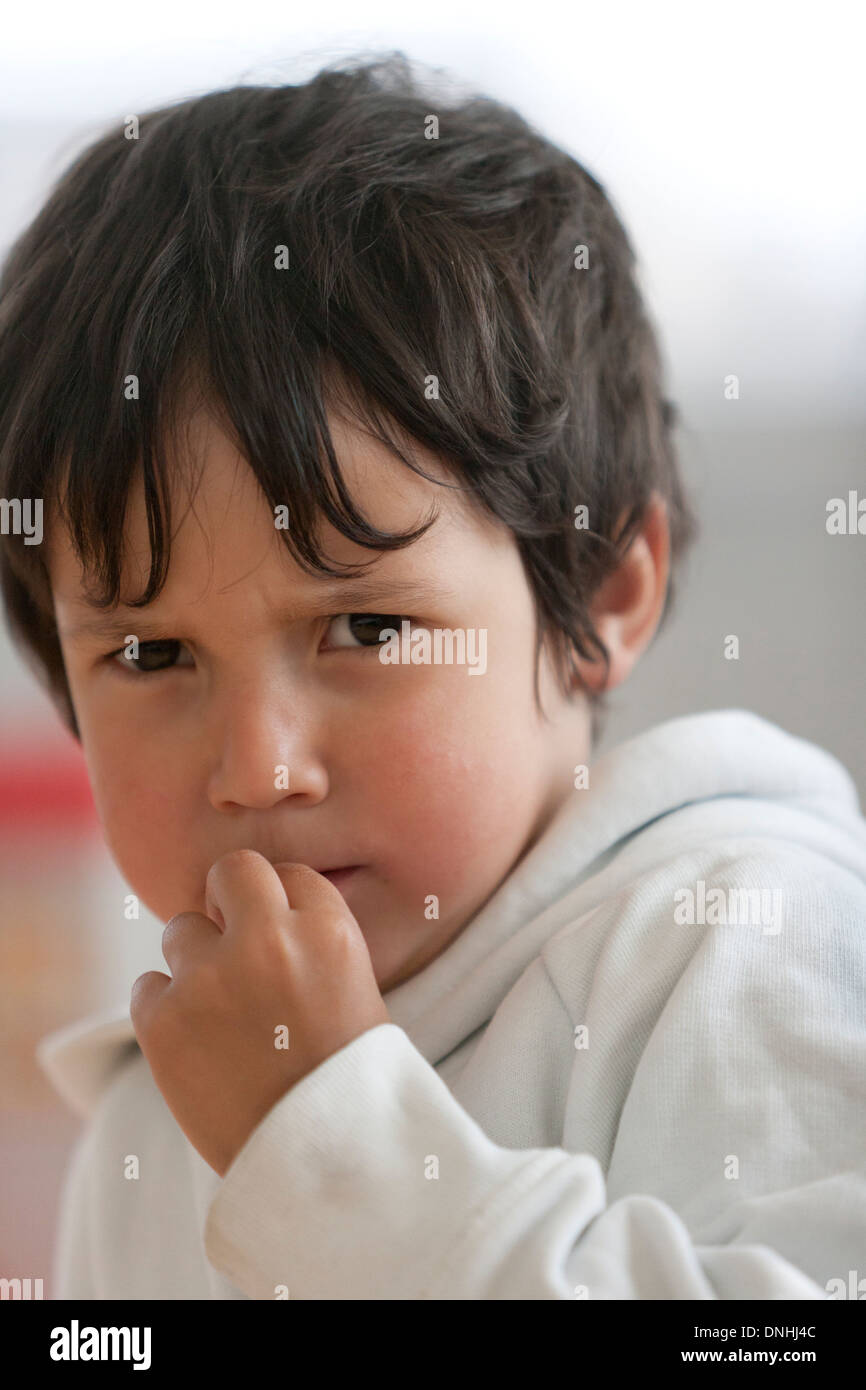 Portrait of an angry little boy - Stock Image