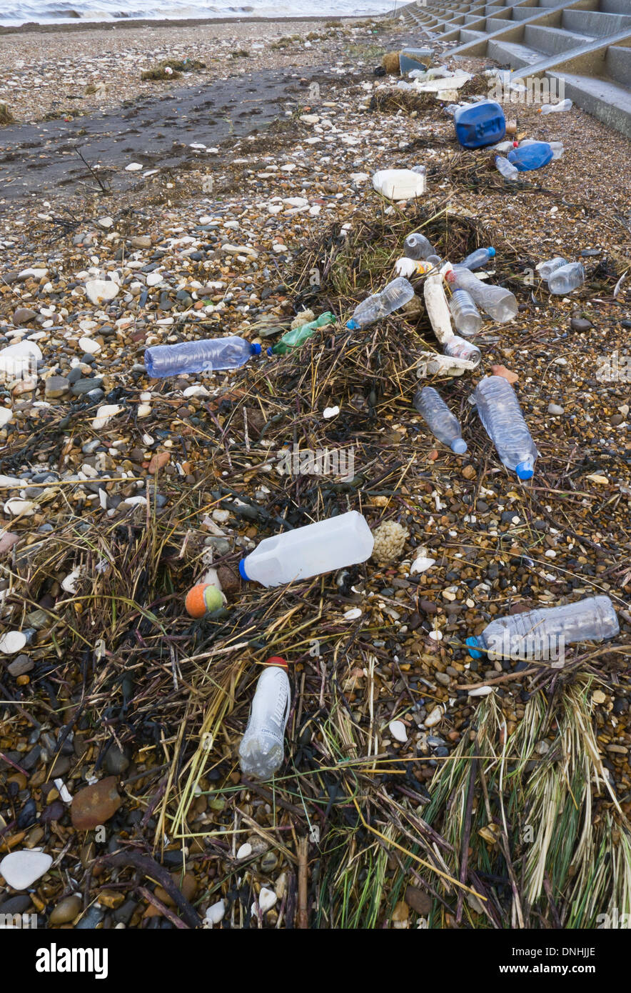 Plastic bottles and containers washed up on a beach in Norfolk. - Stock Image
