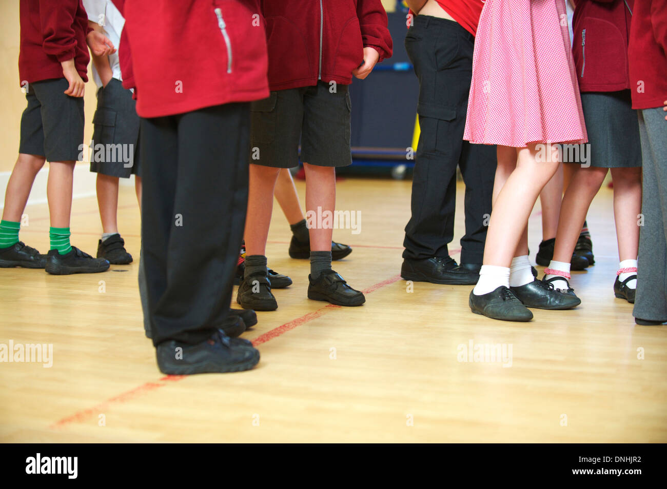 Primary or first school children at their school waiting for assembly - Stock Image