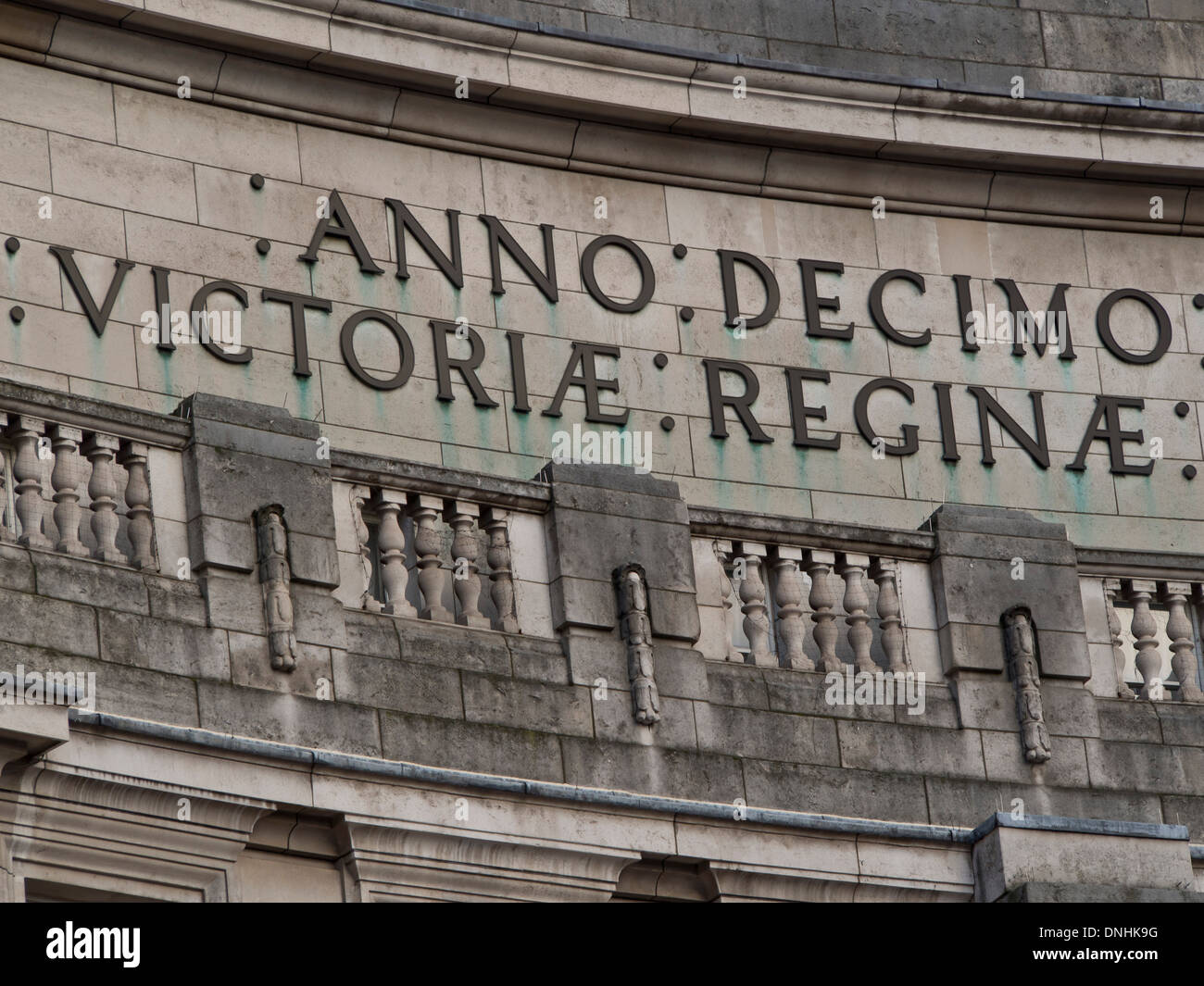 Latin inscription detail of the Admiralty Arch, Pall Mall, London. Commissioned by King Edward VII in memory of Stock Photo