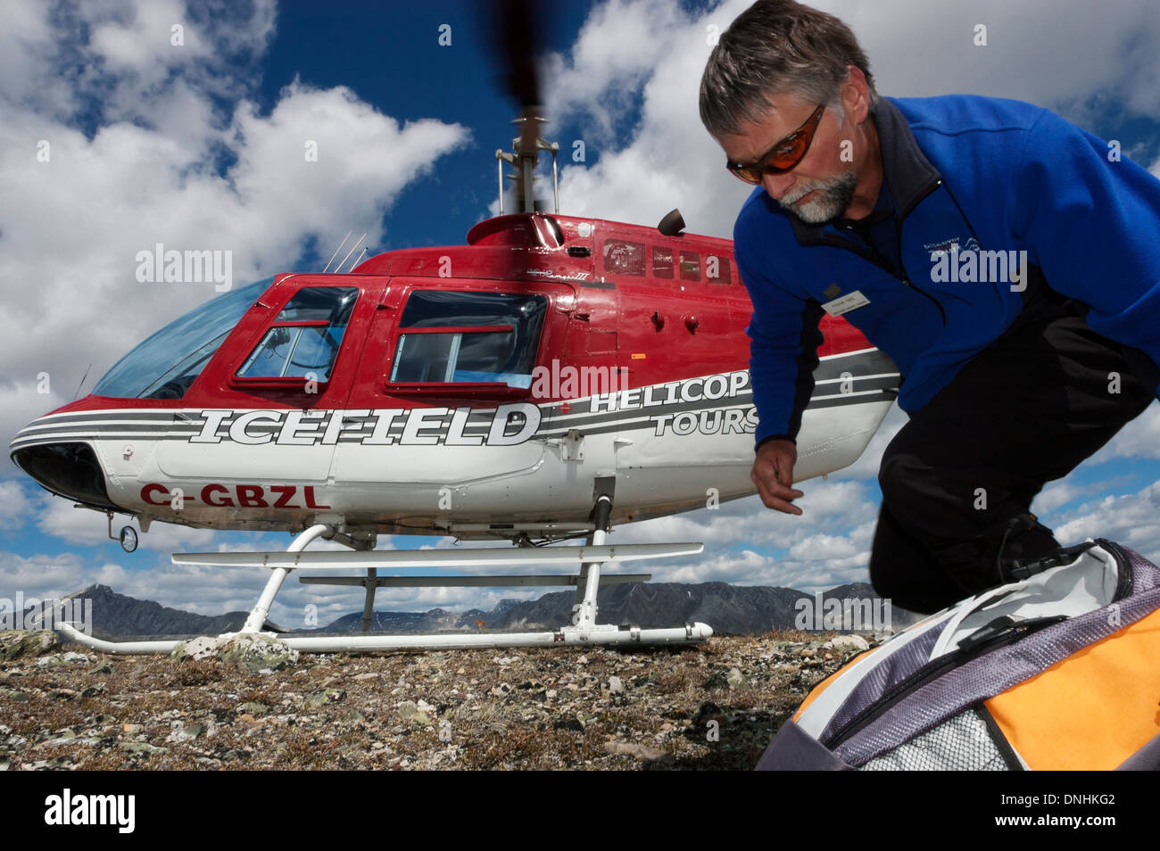 Heli-hiker and helicopter Canadian Rockies Alberta Canada - Stock Image