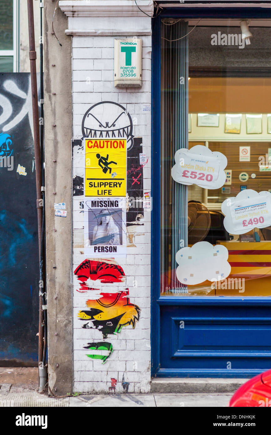 Posters - Missing person and 'caution slippery life'- Hanbury StreetBrick lane, East London, UK - Stock Image