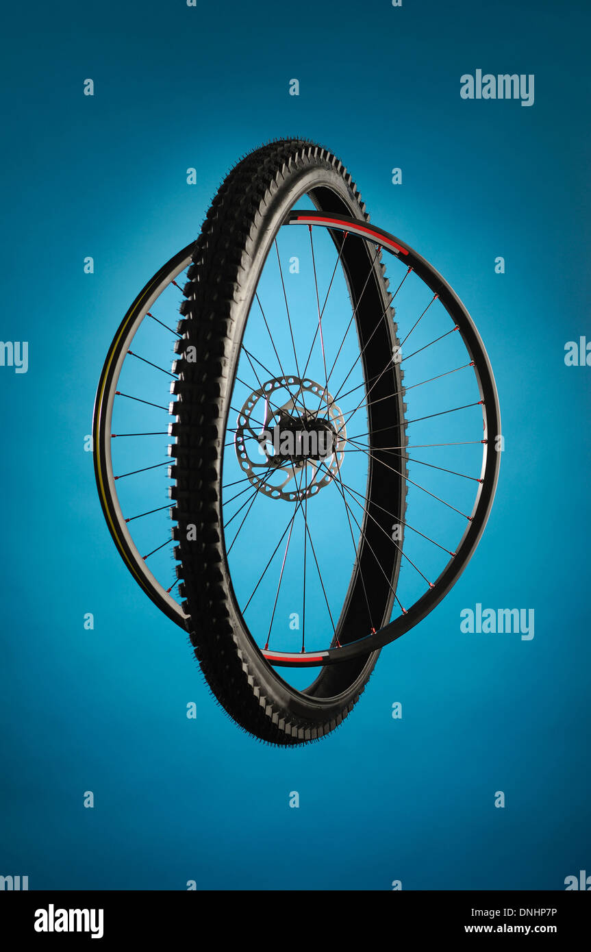 A bicycle wheel and tire separated but together. - Stock Image