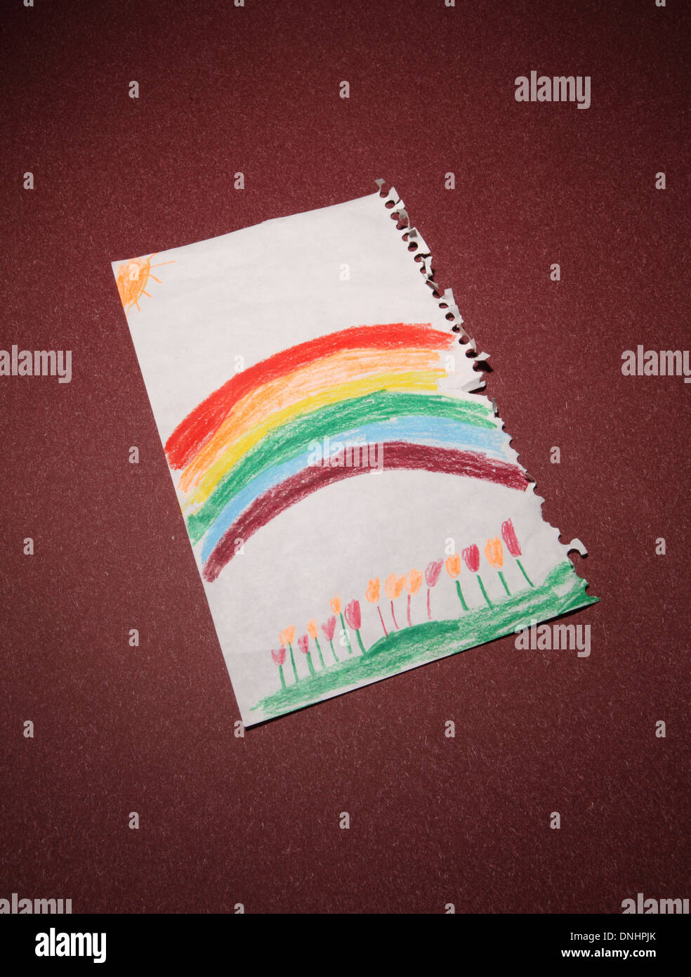 A children\'s colored pencil drawing of a rainbow and flowers Stock ...