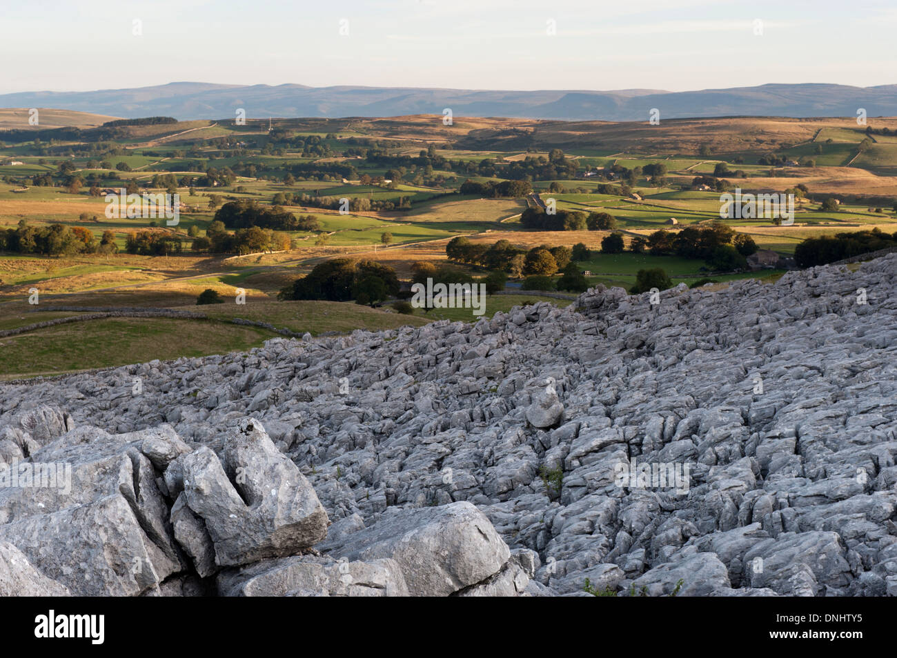 Sunrise over Fell End Clouds, , an area of Limestone paving, looking towards the Eden Valley in Cumbria, UK. - Stock Image