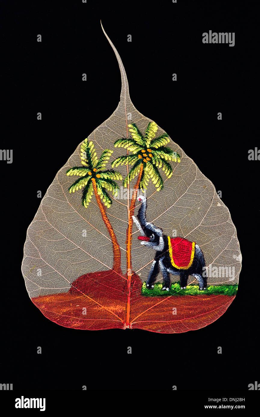 Hand Painted Indian elephant design on a Sacred Fig tree leaf / Bodhi tree leaf on black background - Stock Image