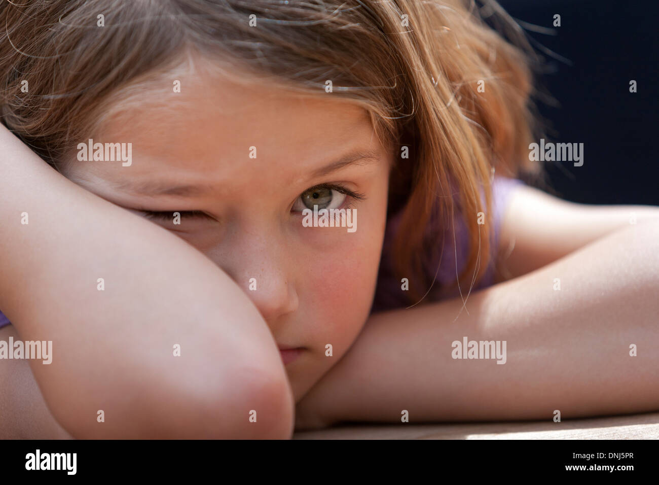 Portrait of a bad tempered 10 year old girl - Stock Image