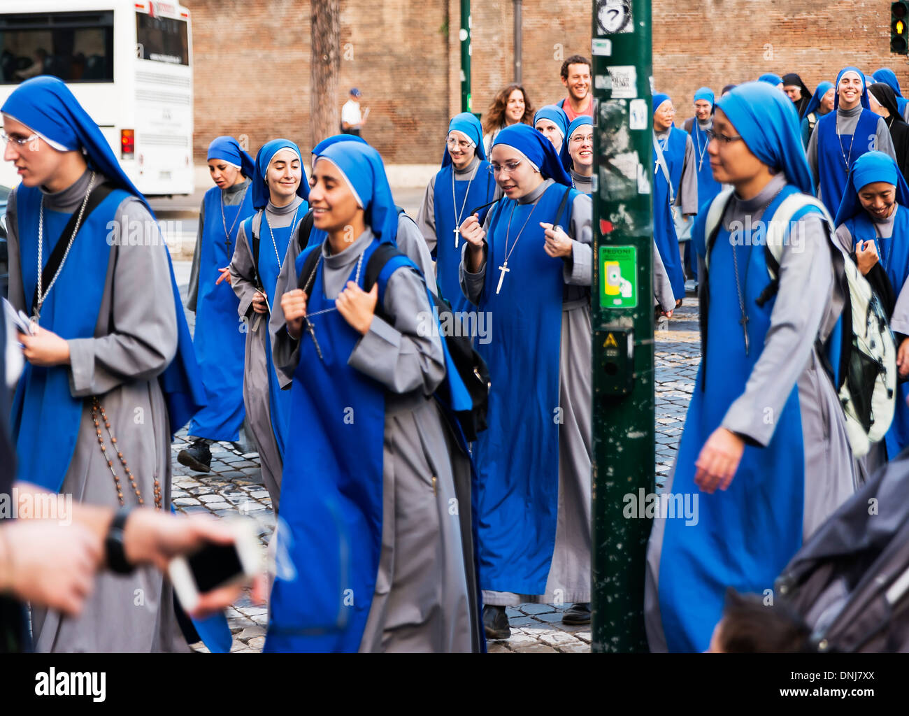 Group of young nuns of the Servants of the Lord religious order explore the sights of ancient Rome, Italy - Stock Image