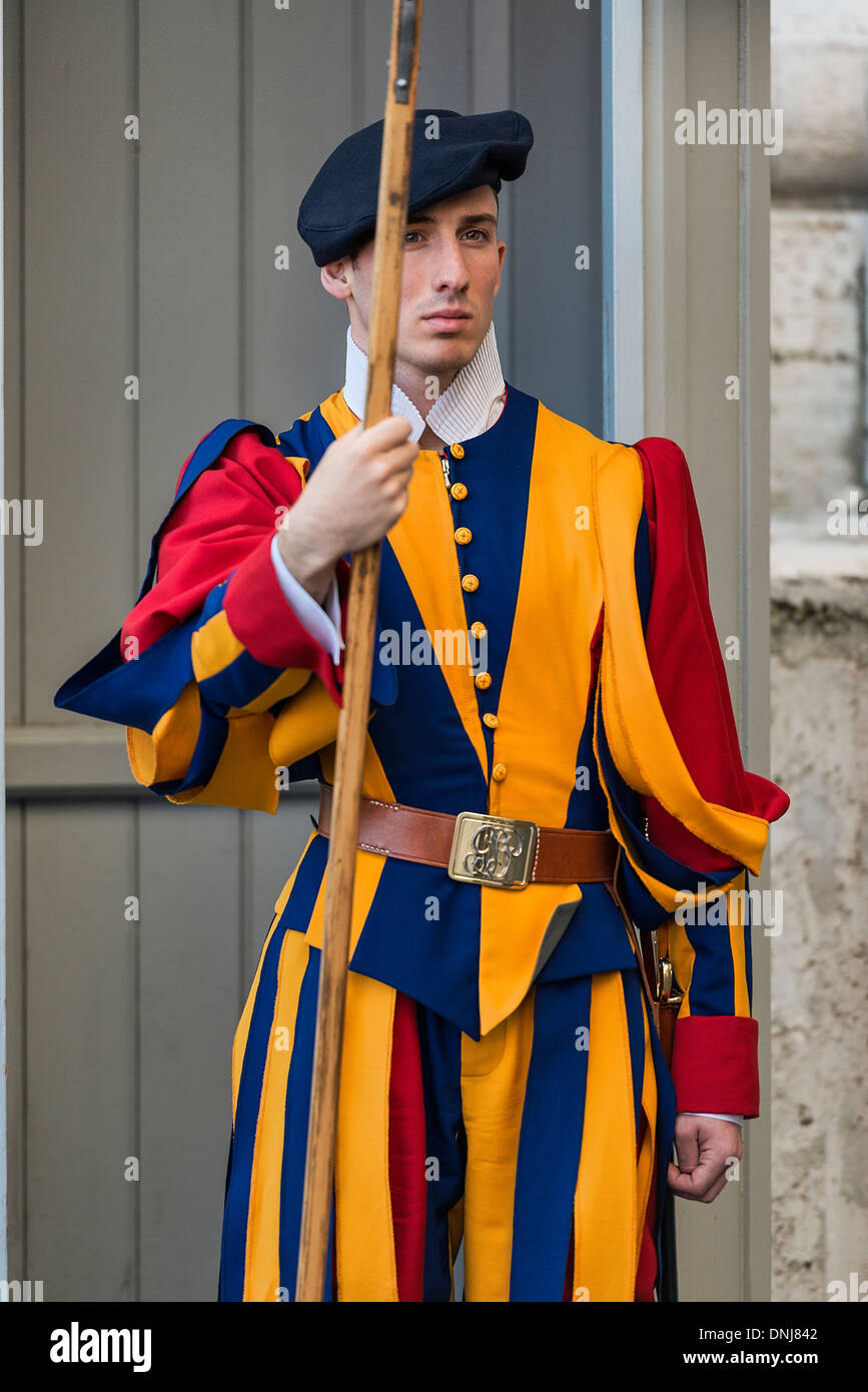 Pontifical Swiss Guard stands at attention. - Stock Image