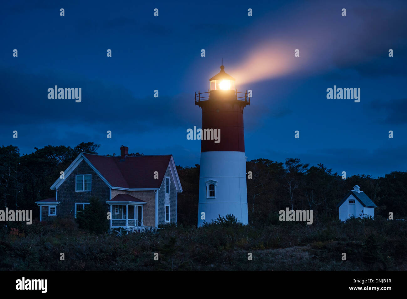 Nauset Light shines at night, Cape Cod National Seashore, Eastham, Cape Cod, MA, USA - Stock Image