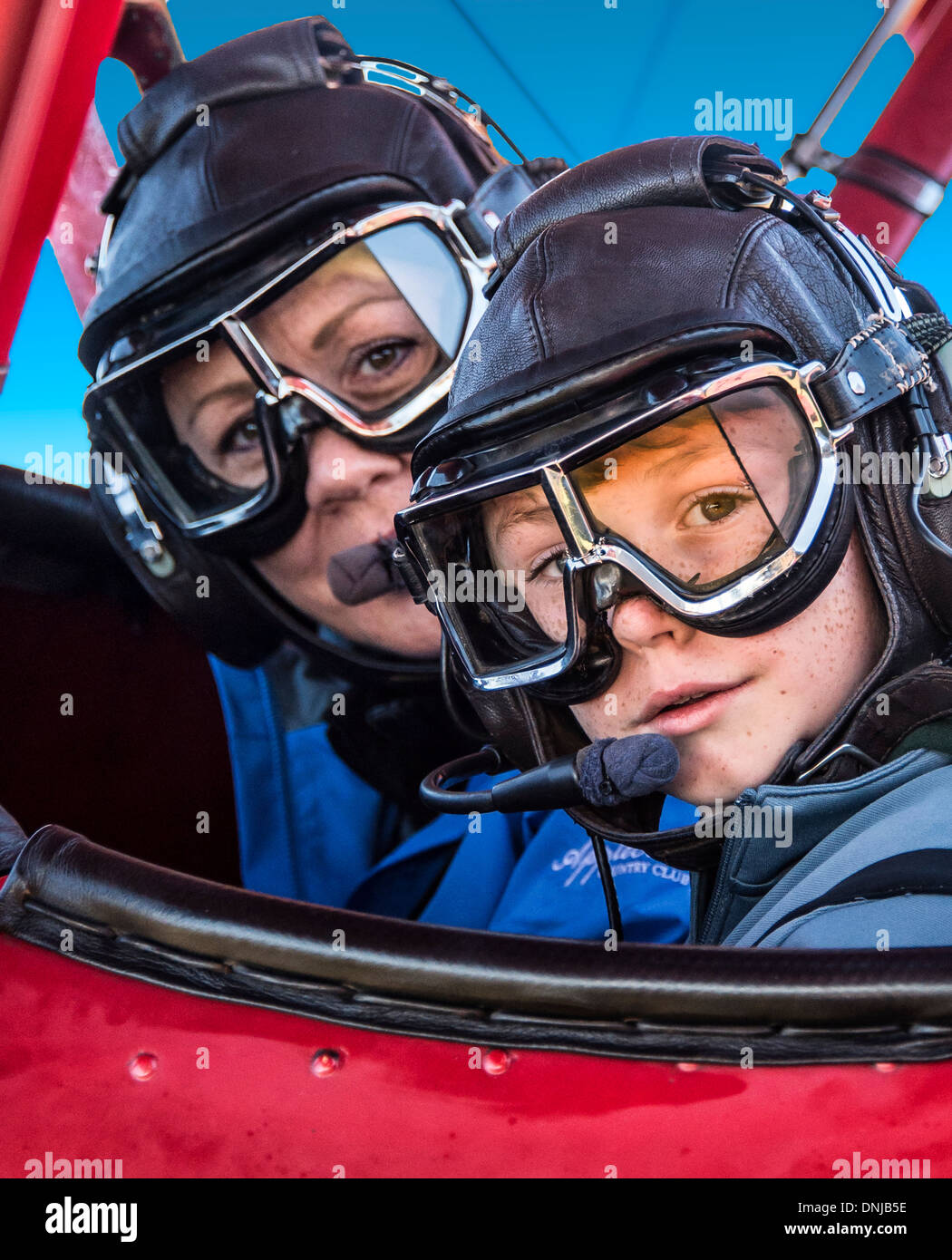 Mother and son ready for an exhilarating plane ride. - Stock Image