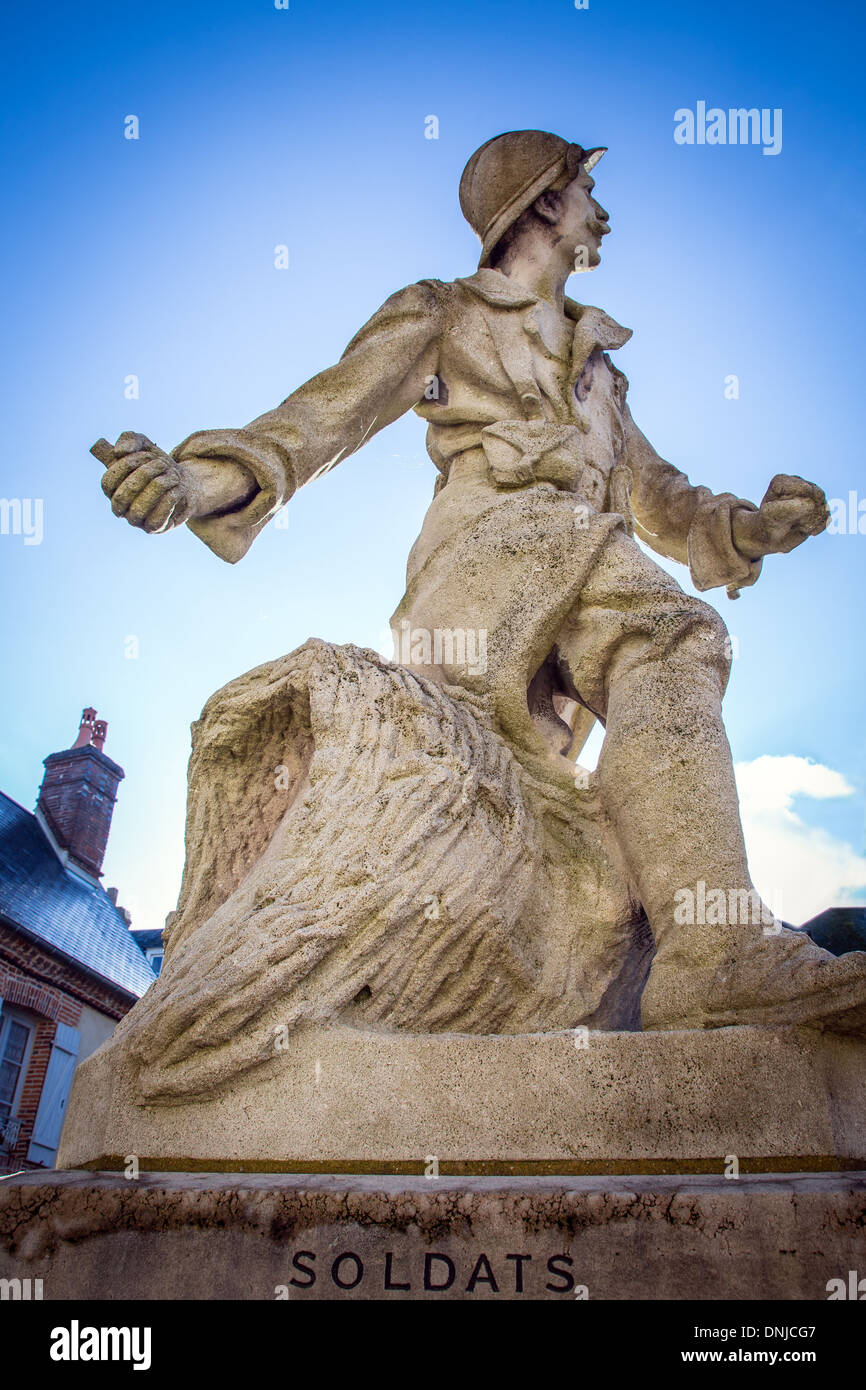 FRENCH SOLDIER OF THE GREAT WAR WITH A GRENADE IN HIS HAND, WORLD WAR ONE WAR DEAD MEMORIAL, RUGLES, EURE (27), FRANCE - Stock Image