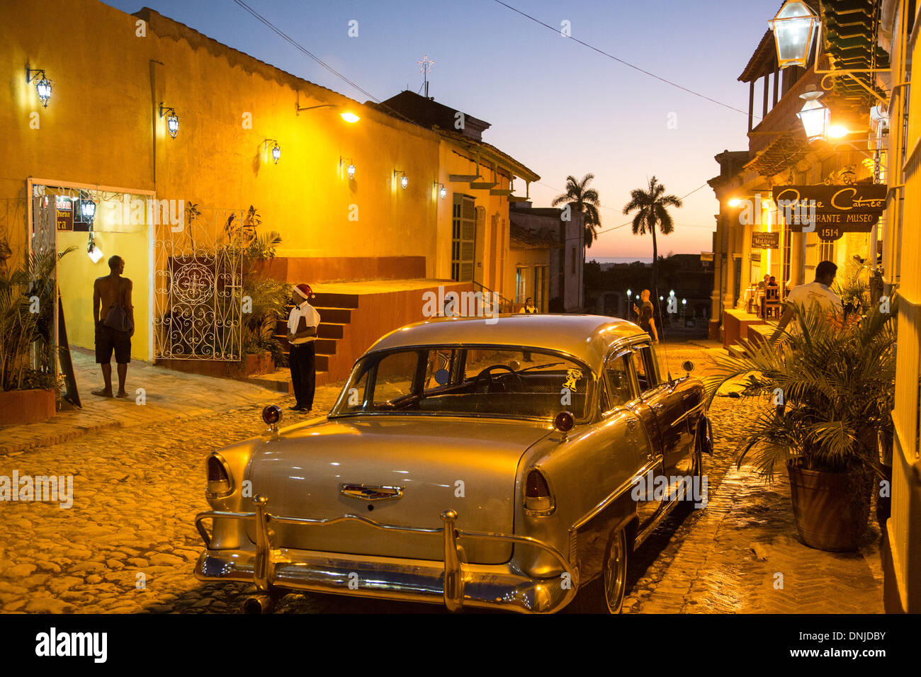 OLD AMERICAN CAR AND RESTAURANTS AT NIGHT, CALLE SIMON BOLIVAR Stock ...