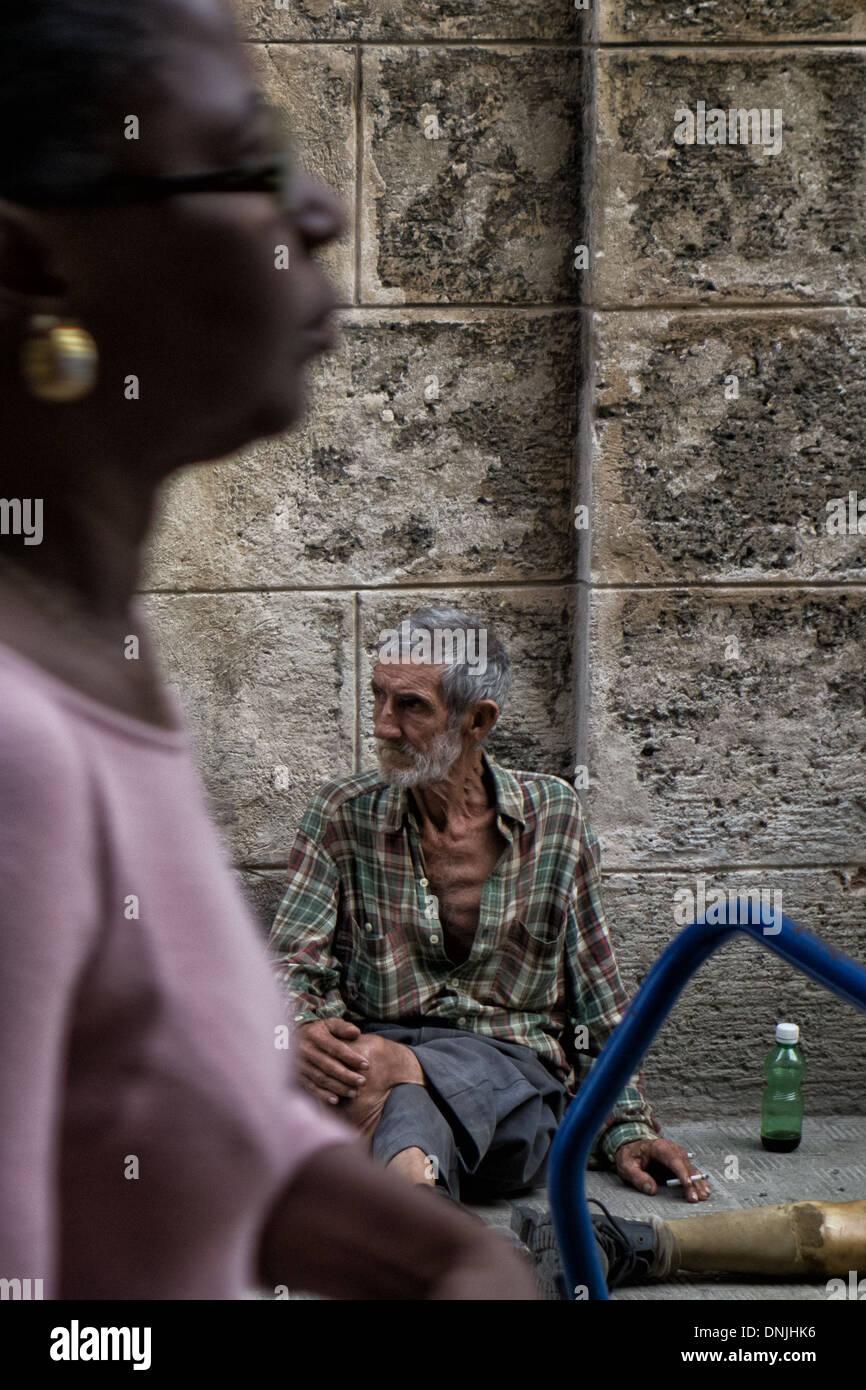 LAME BEGGAR ON OBISPO STREET, HAVANA, CUBA, THE CARIBBEAN - Stock Image