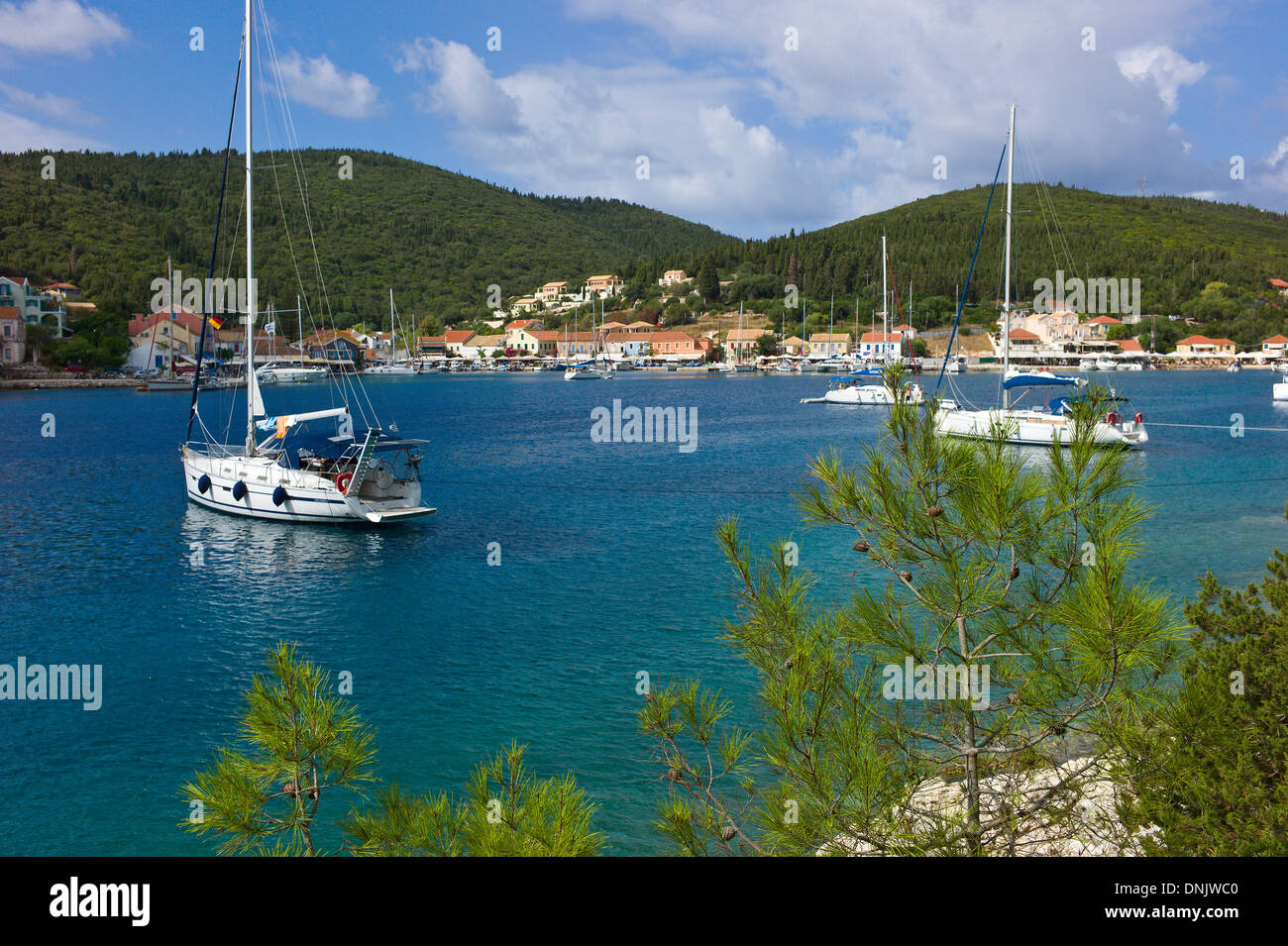 Yacths moored in Fiscardo harbour, Kefalonia, Greece - Stock Image