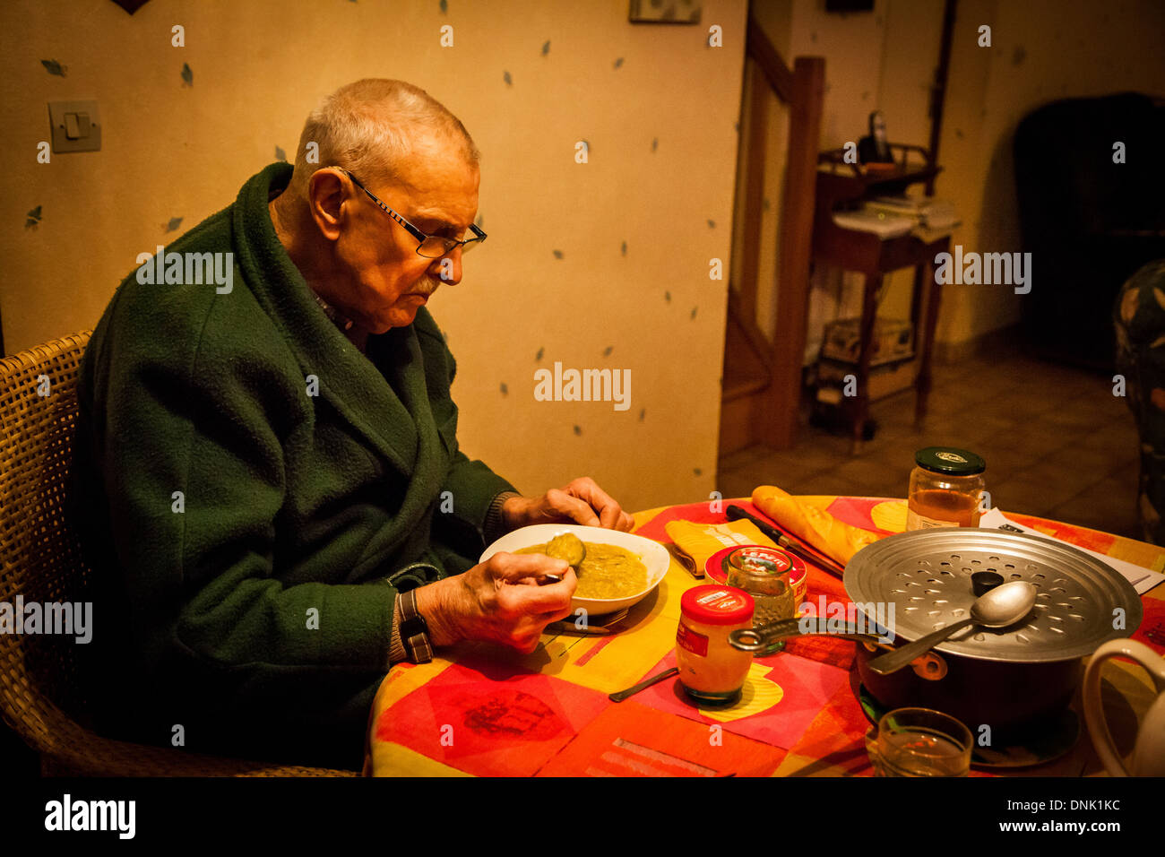 ILLUSTRATION OF AGEING AT HOME, ELDERLY PERSON AT HOME HAVING A MEAL - Stock Image