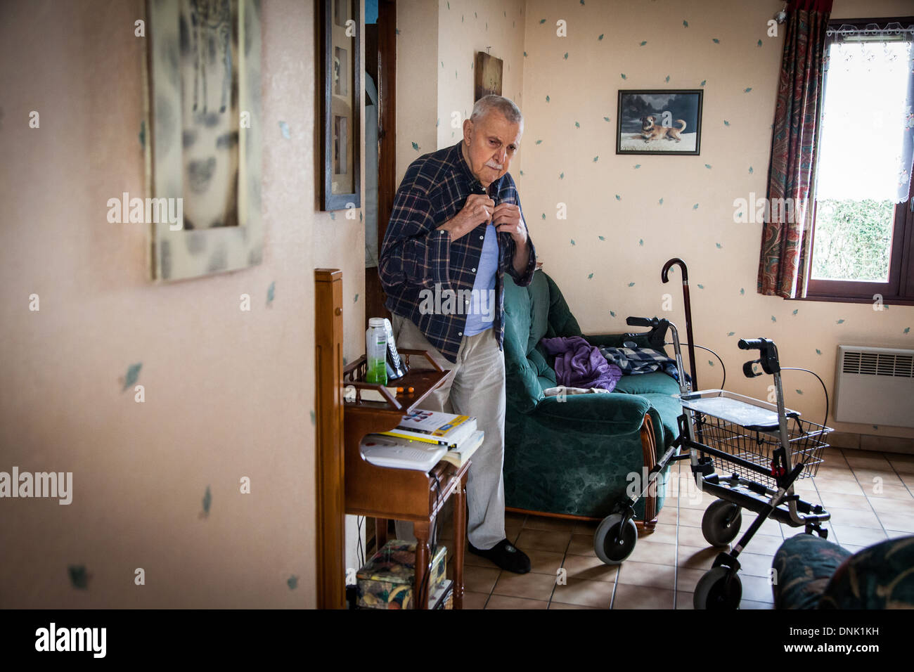 ILLUSTRATION OF AGEING AT HOME, ELDERLY PERSON AT HOME GETTING DRESSED - Stock Image