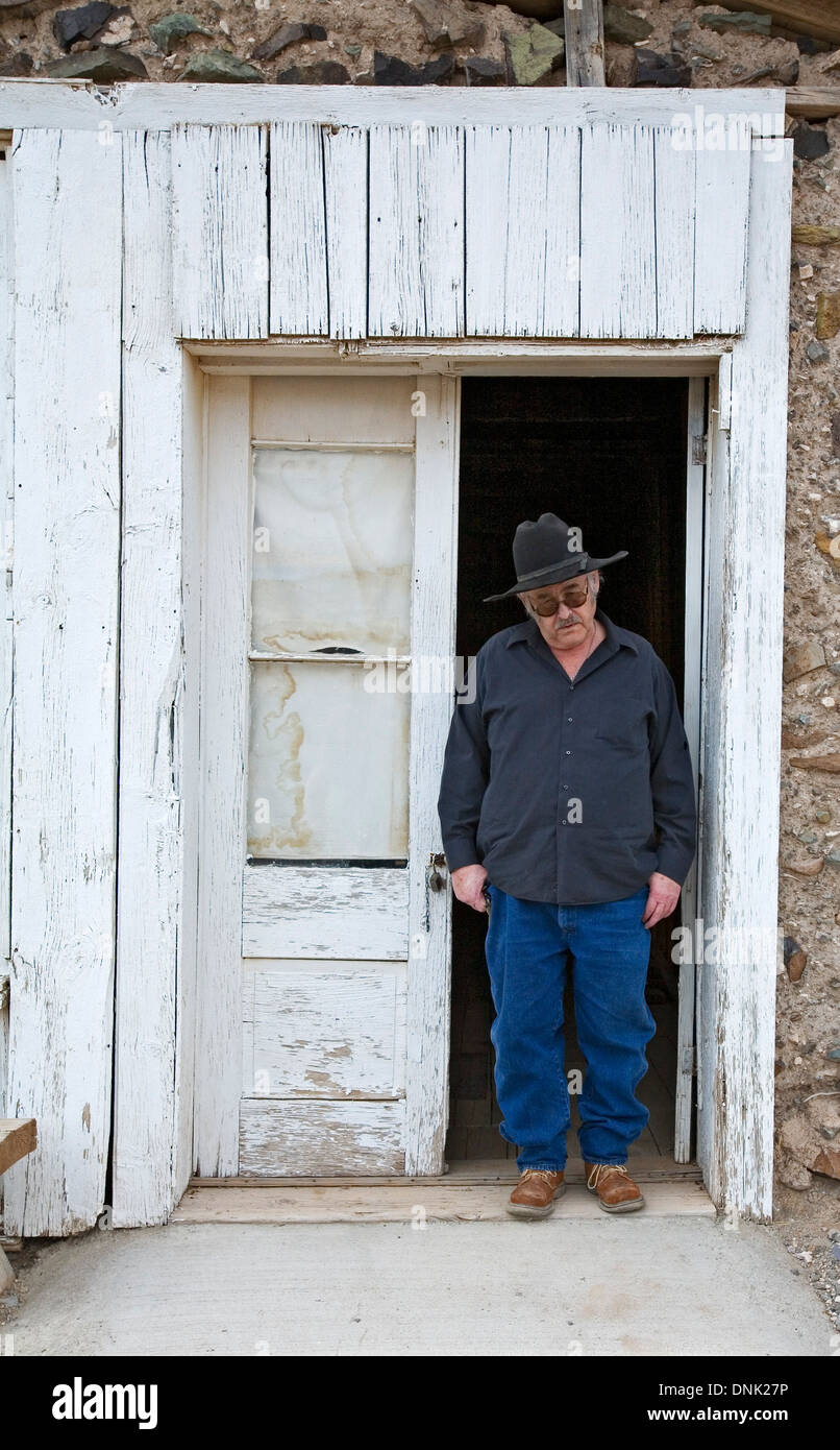 Guide/owner Manny Hough in front of Stratford Hotel ruins Shakespeare Ghost Town Lordsburg New Mexico USA & Guide/owner Manny Hough in front of Stratford Hotel ruins Stock ...