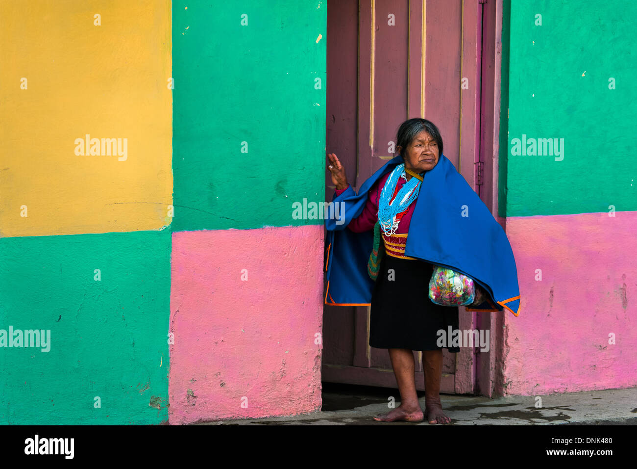A native woman from the Kamentsá tribe watches the procession of the Carnival of Forgiveness in Sibundoy, Colombia. - Stock Image
