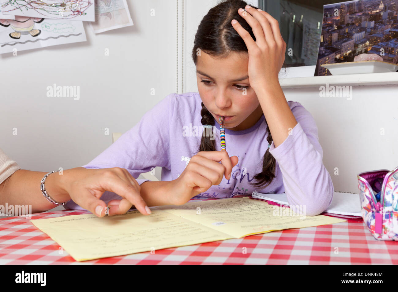 Girl having private tuition at home - Stock Image