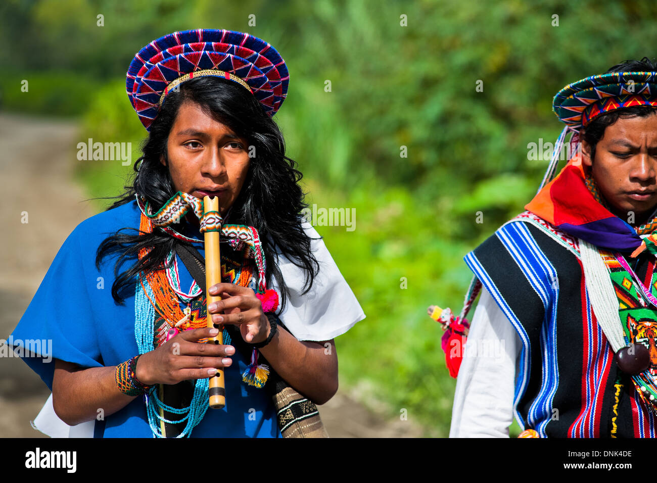 A native from the Kamentsá tribe plays flute during the Carnival of Forgiveness in Sibundoy, Colombia. - Stock Image