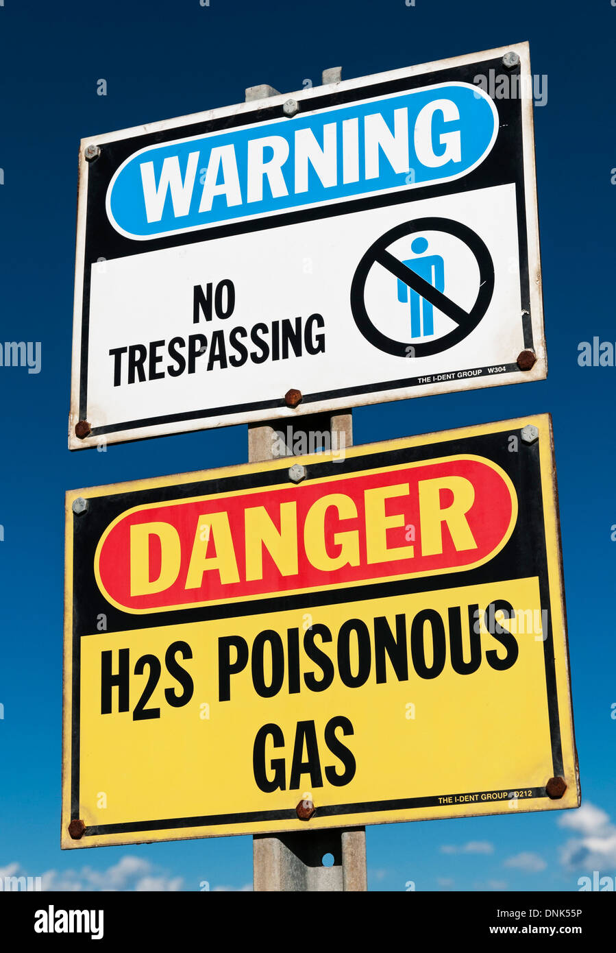 Warning signs: no trespassing and poisonous H2S ( hydrogen sulphide) gas, near Olds, Alberta, August 19, 2013. - Stock Image