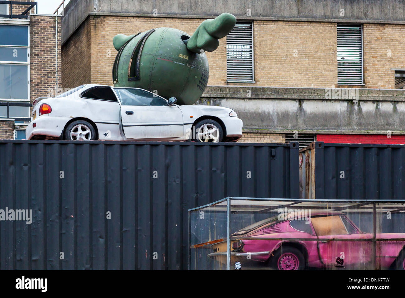 Street Installation Art Car Crushed By Green Flying Bomb And Pink Stock Photo Alamy