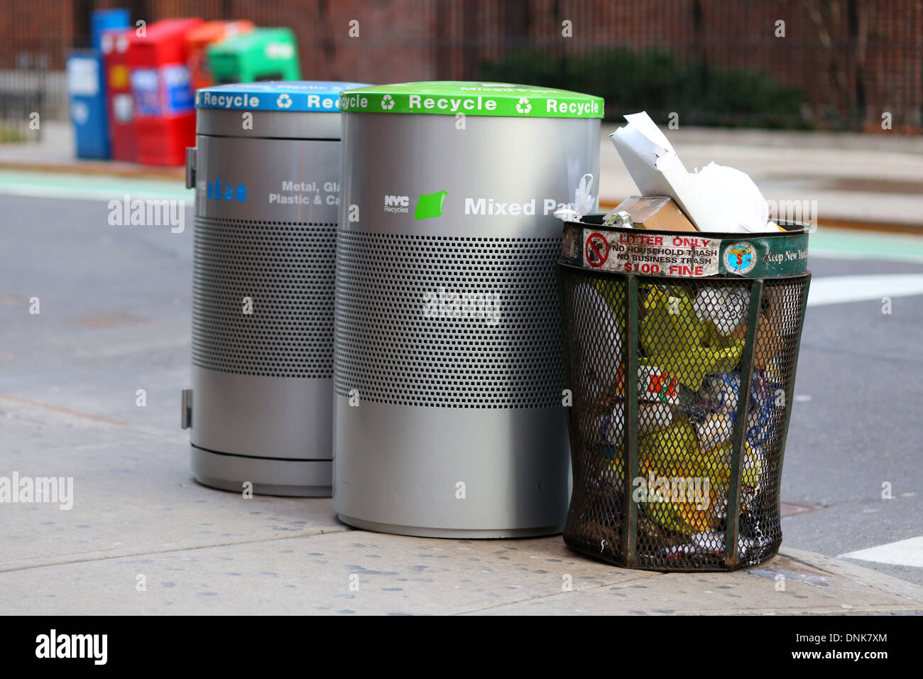 NYC garbage can and recycling bins for mixed paper, glass, metal, and plastics. - Stock Image