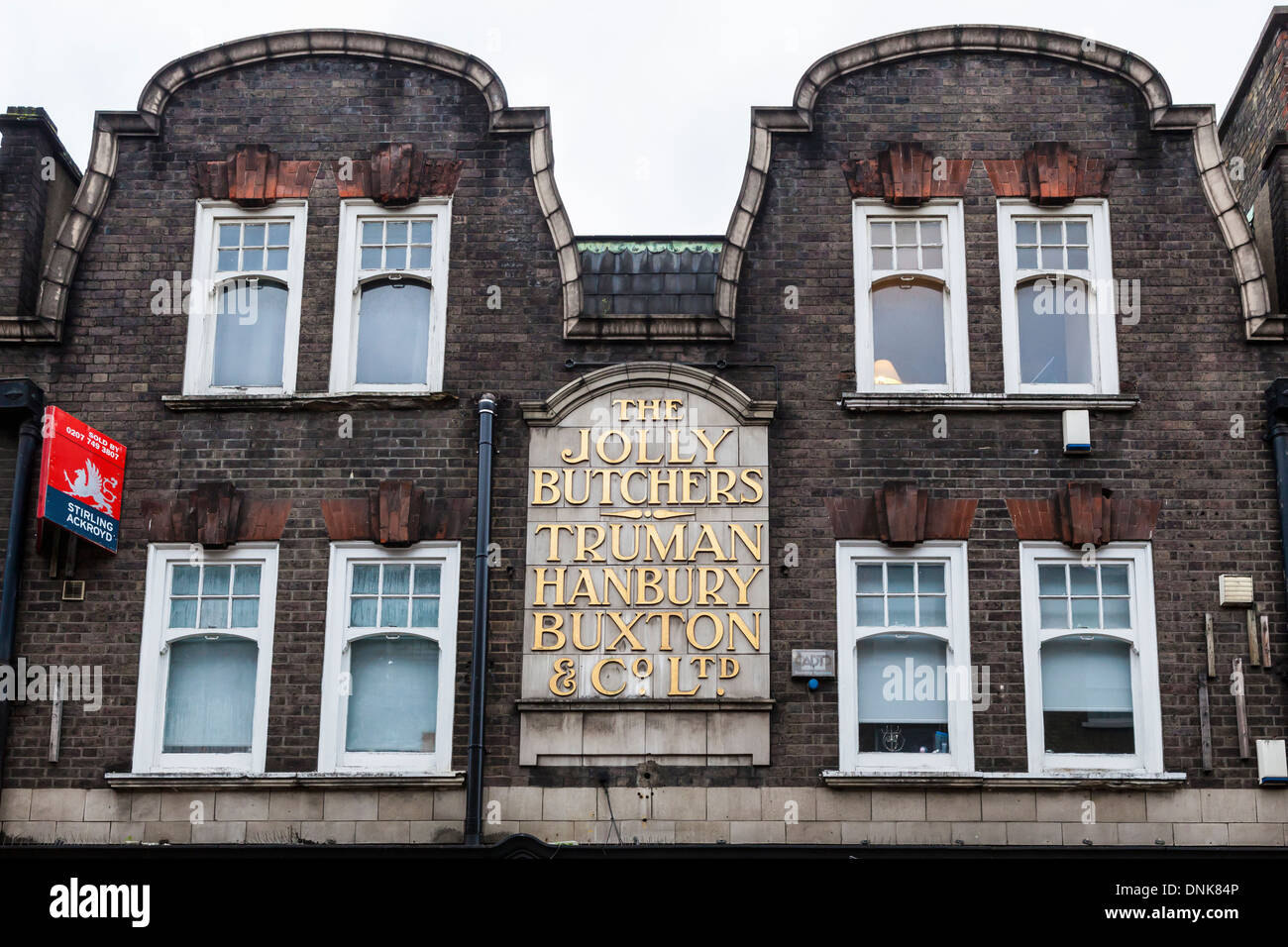 'The Jolly Butchers' Truman Brewery sign on old building in Brick lane, East London, UK - Stock Image