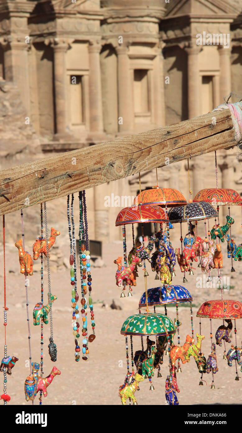Souvenirs hanging from stall in front of the Monastry, Petra - Stock Image
