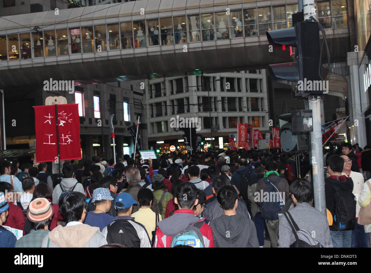 Hong Kong, China. 1st January 2014. Pro-democracy marchers parade through Hong Kong's business district on New Year's Stock Photo