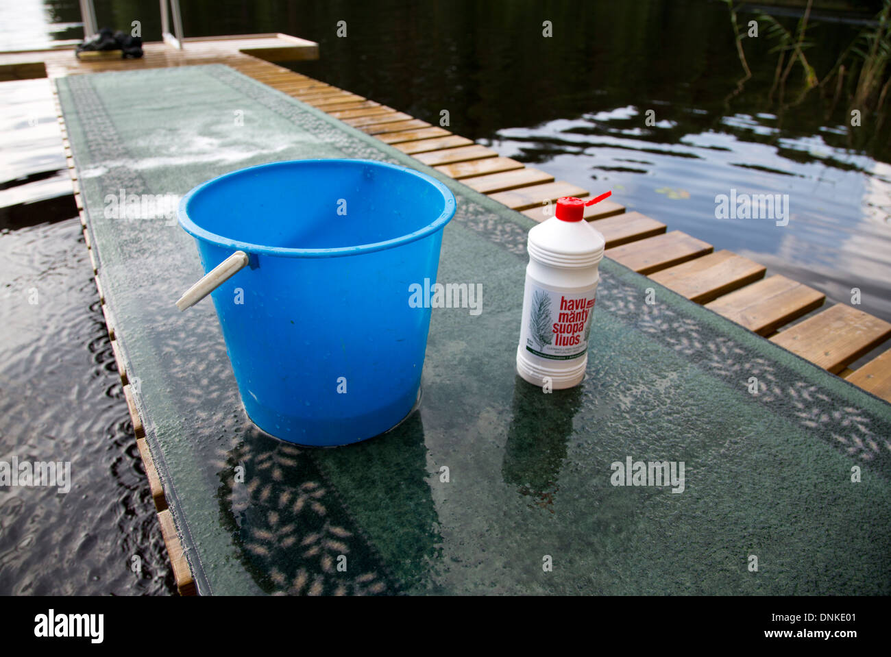 Tall oil soap used as carpet washing detergent and a water bucket Stock Photo