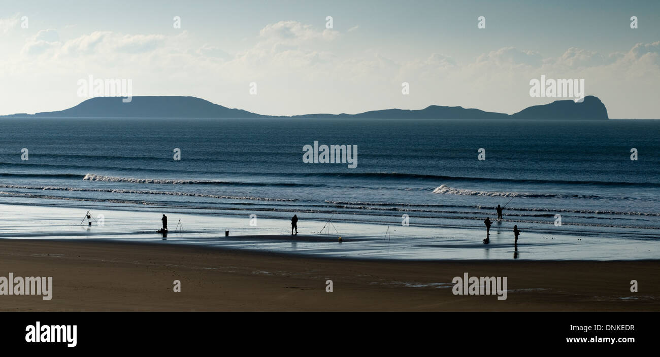 Sea anglers, Llangennith beach Stock Photo