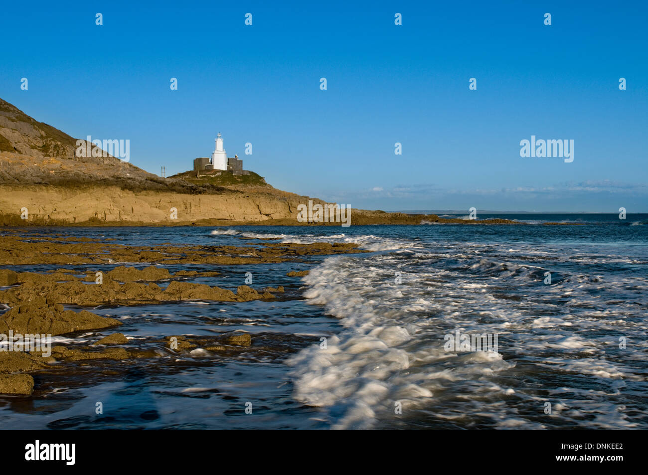 Mumbles Lighthouse viewed from Bracelet Bay Stock Photo