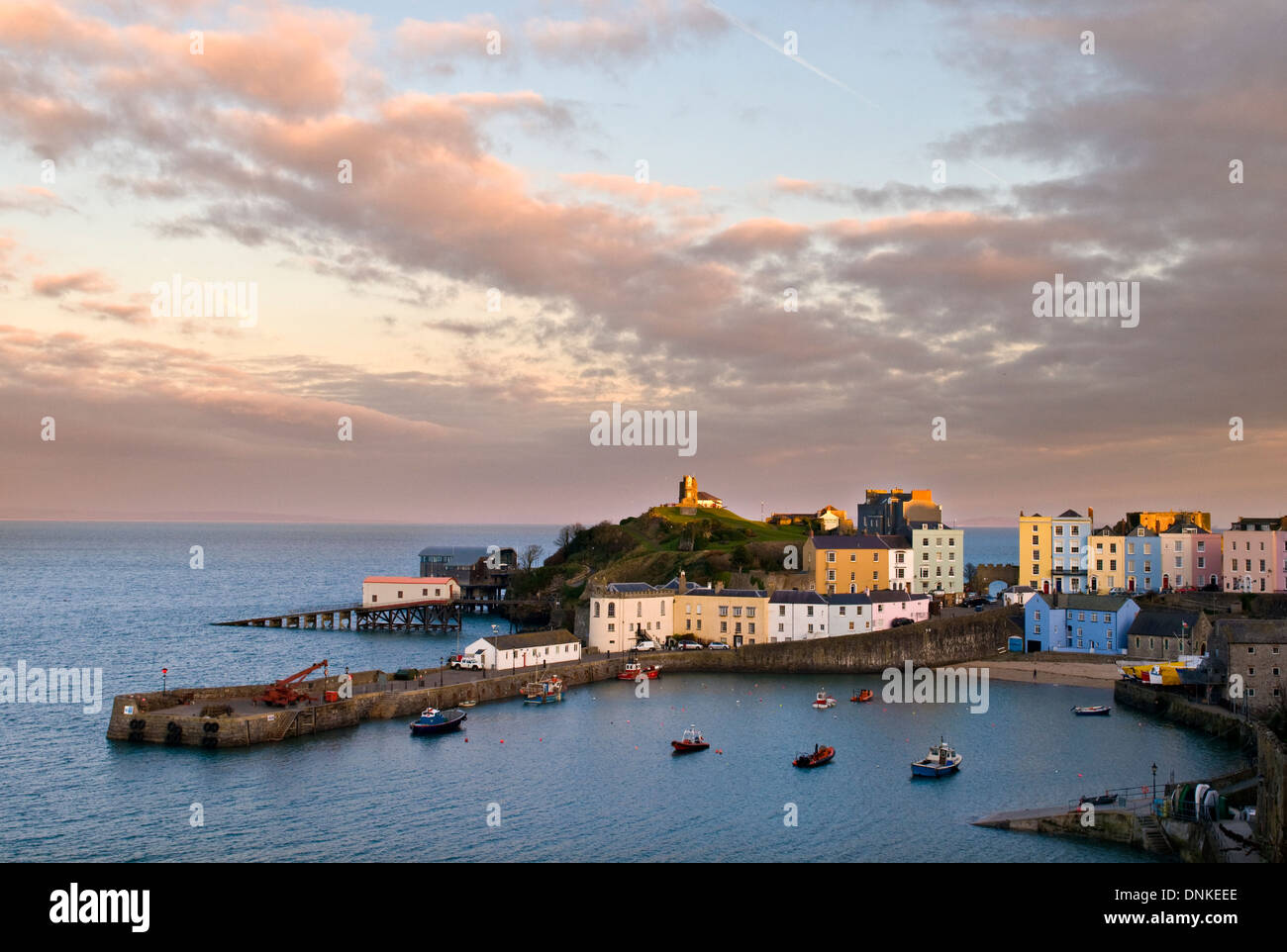 Tenby harbour at sunset in winter Stock Photo