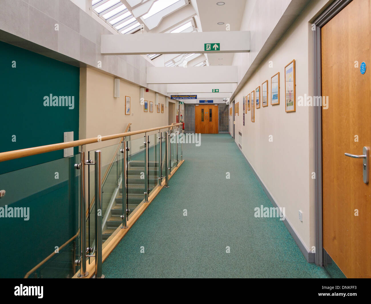 View along an empty corridor to the Highways Department in Ynys Mon County Council office building Llangefni Anglesey Wales UK - Stock Image