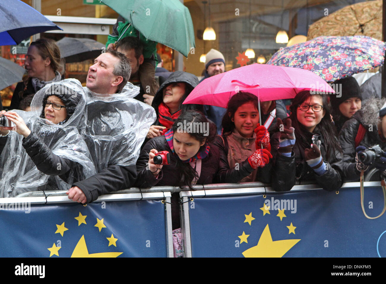 London,UK,1st January 2014,Crowds wait in the rain for the London's New Year's Day Parade 2014 Credit: Keith Larby/Alamy Live News - Stock Image