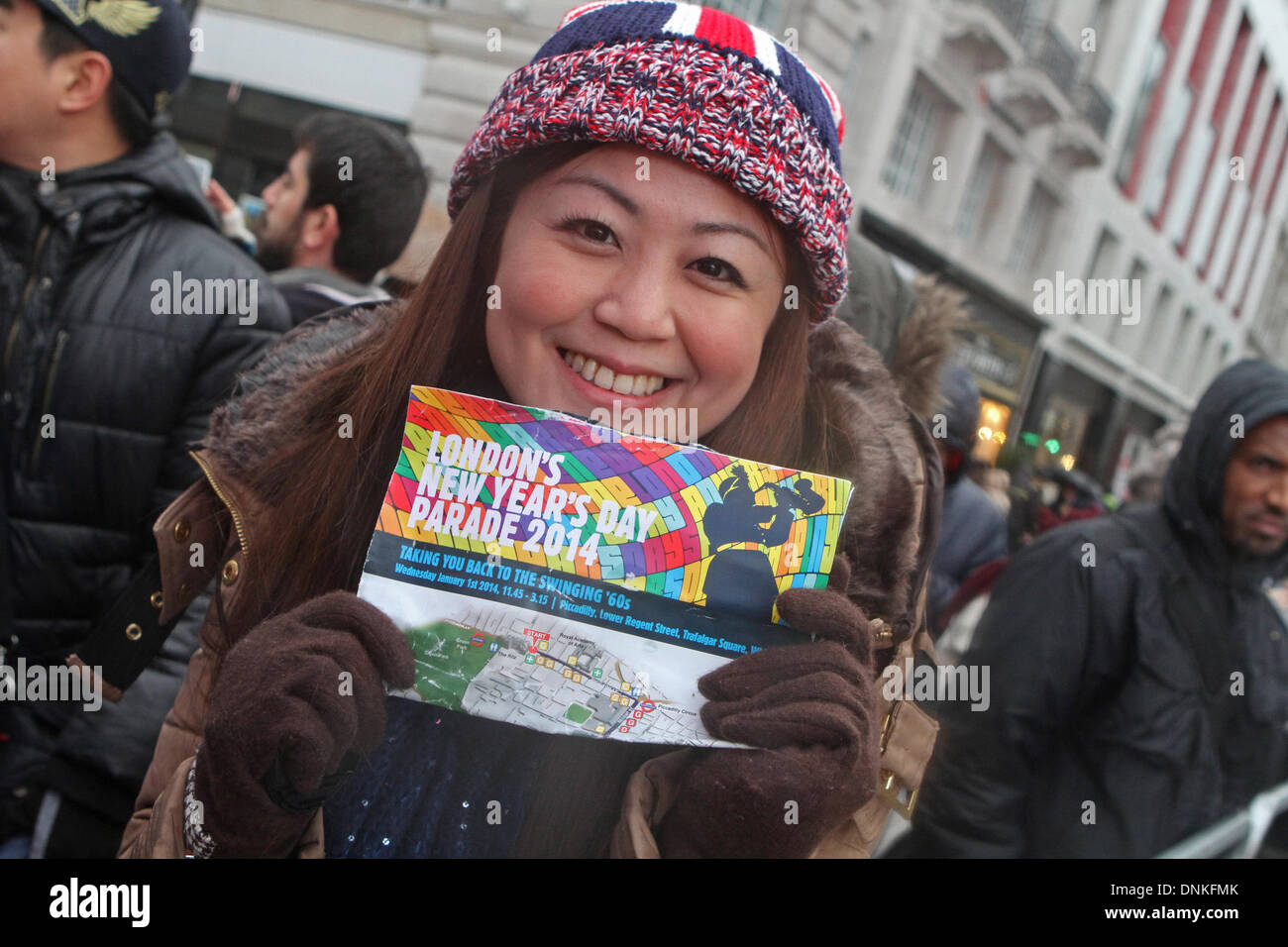 London,UK,1st January 2014,Waiting, despite the rain, for the London's New Year's Day Parade 2014 Credit: Keith Larby/Alamy Live News - Stock Image