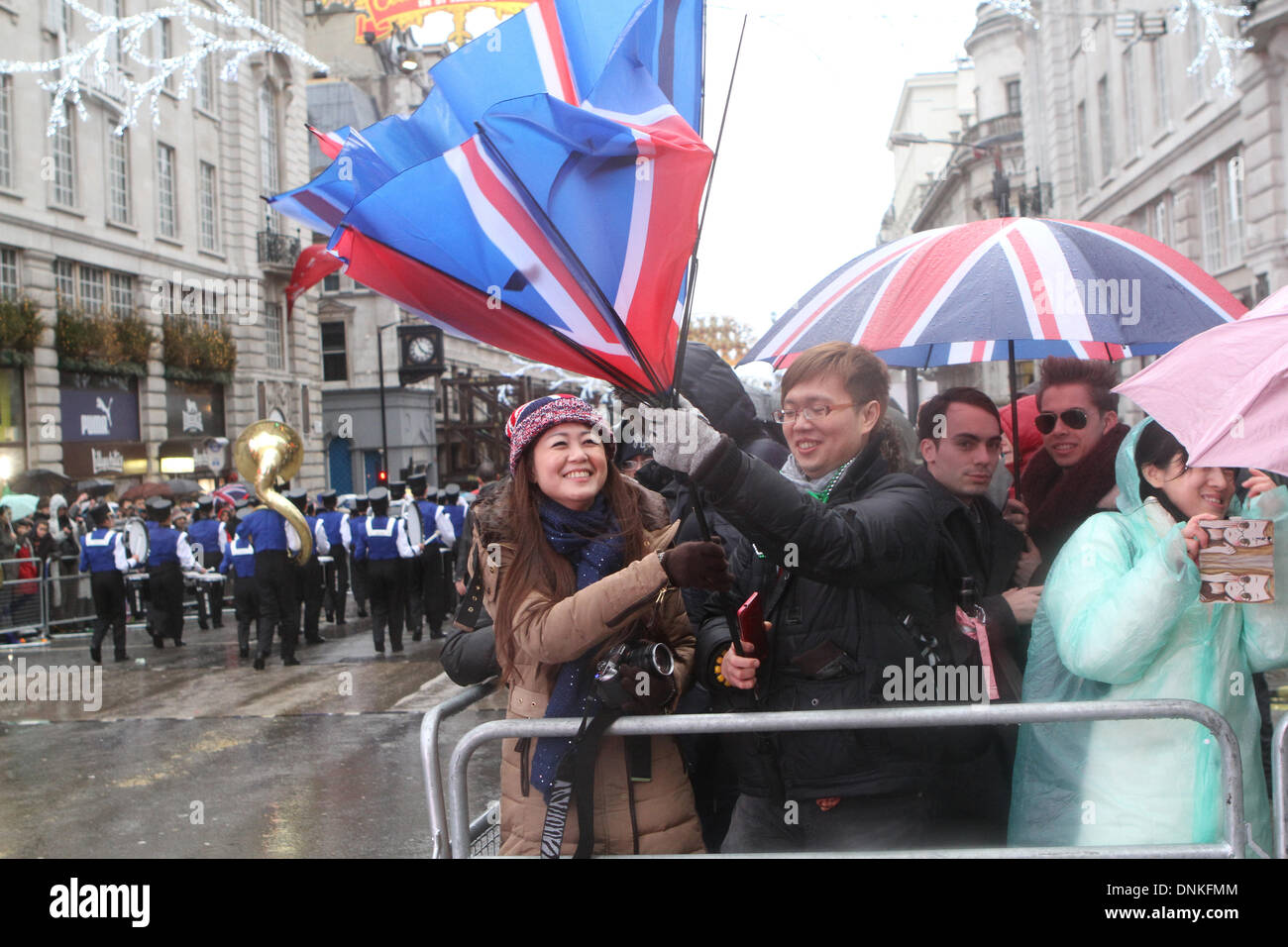 London,UK,1st January 2014,Strong Winds blew umbrellas inside out at the London's New Year's Day Parade 2014 Credit: Stock Photo