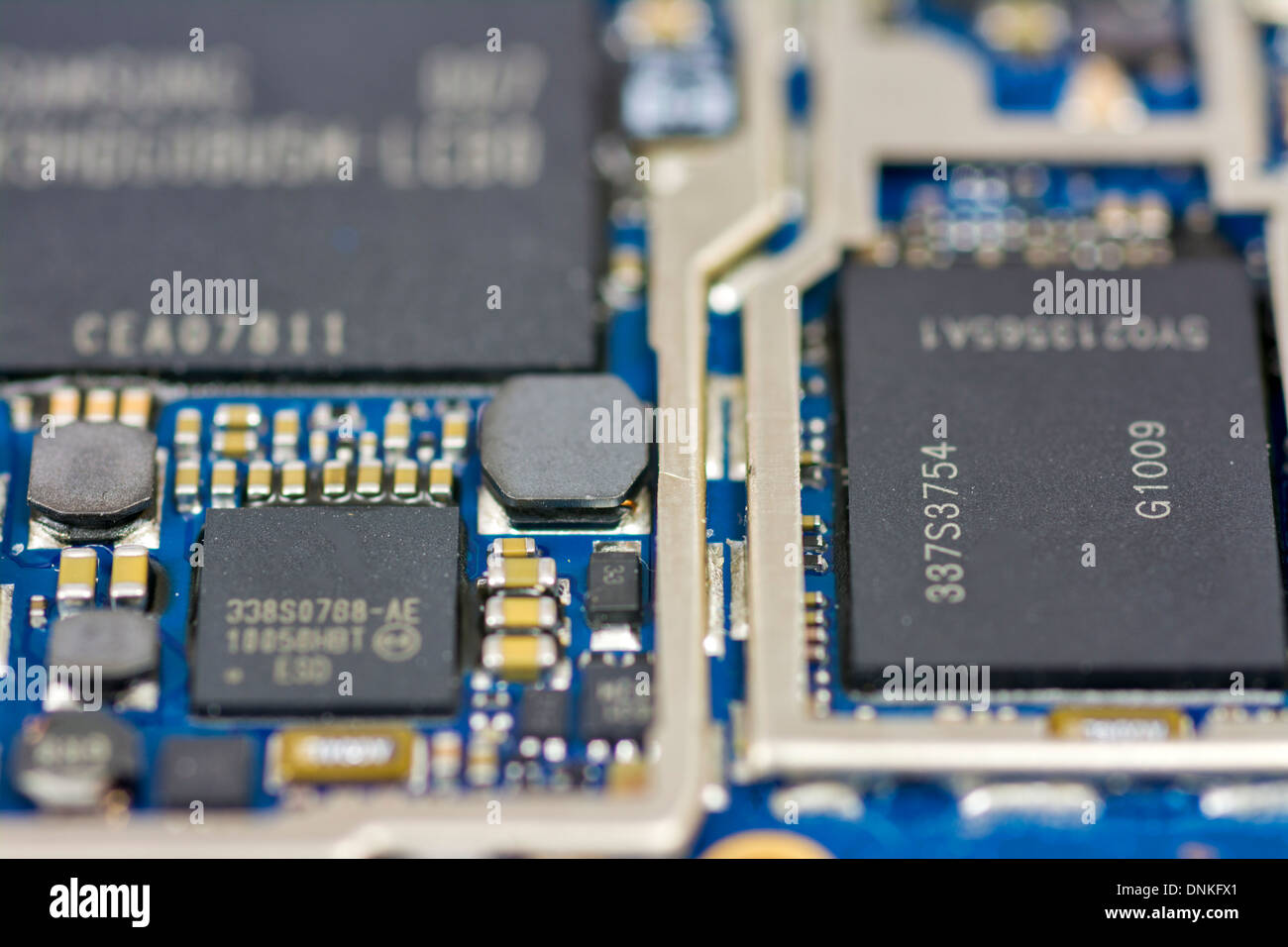 miniature circuit board with computer chips on it - Stock Image