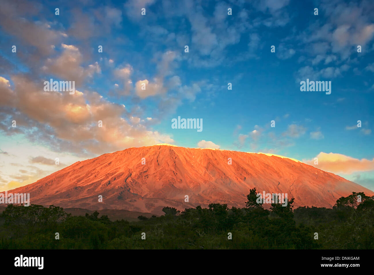Mount Kilimanjaro in Tanzania as seen from the first stage of the Rongai route to the summit of this majestic mountain. - Stock Image