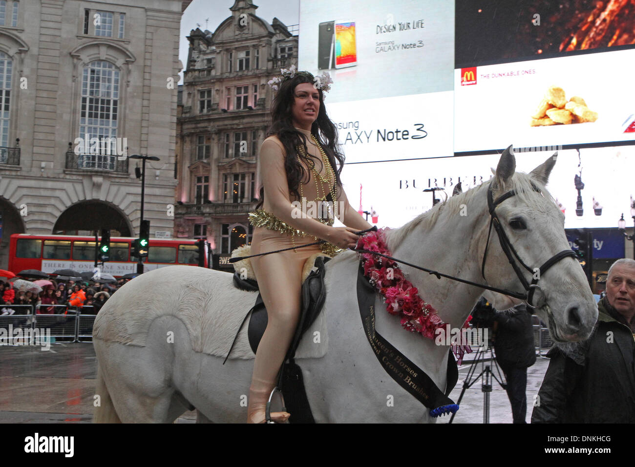 London,UK,1st January 2014,Lady Godiva on horseback at the London's New Year's Day Parade 2014 Credit: Keith Larby/Alamy Live News - Stock Image