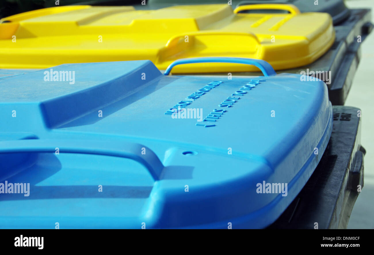coloured plastic rubbish bins - Stock Image