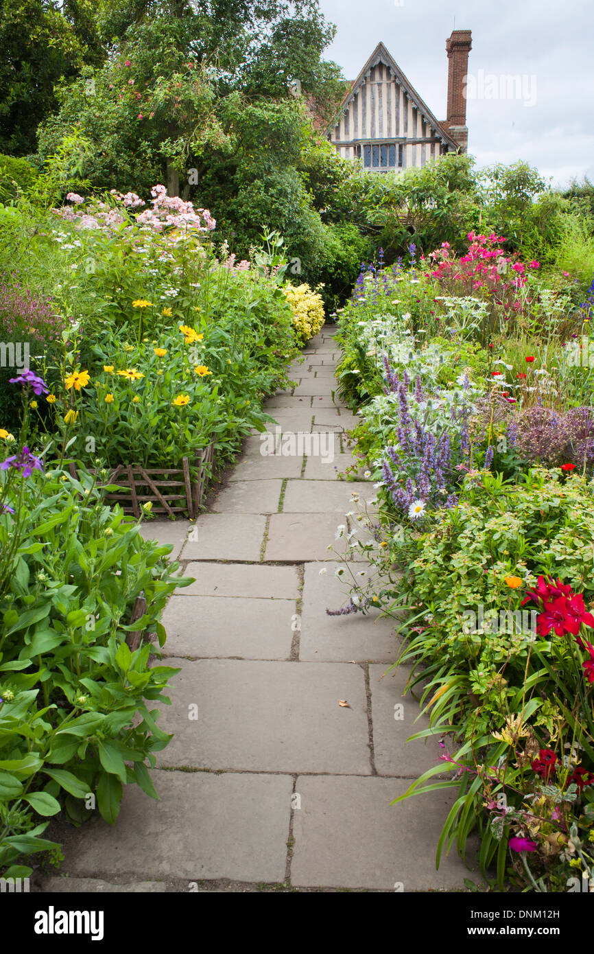 Path through summer borders at Great Dixter, Sussex. Stock Photo