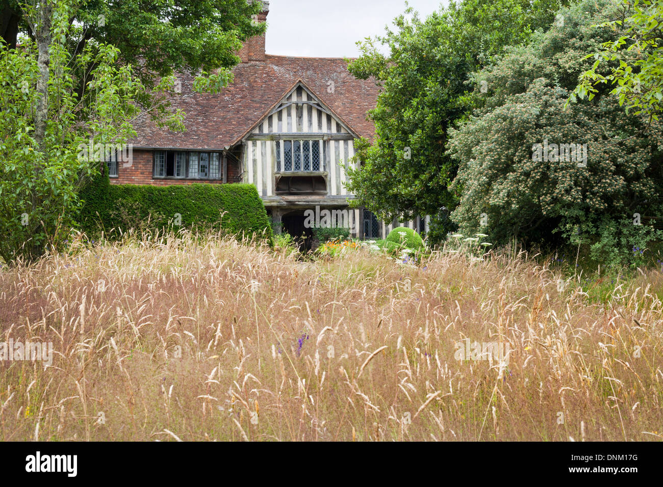 View across the meadow towards the house.Great Dixter, Sussex. Stock Photo