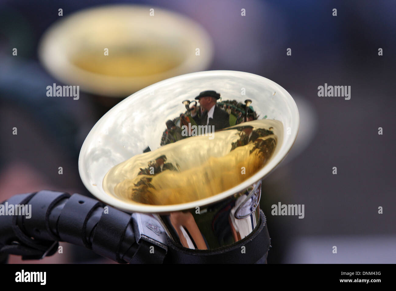 Hannover, Germany, Jagdhornbläser reflected in a hunting horn - Stock Image