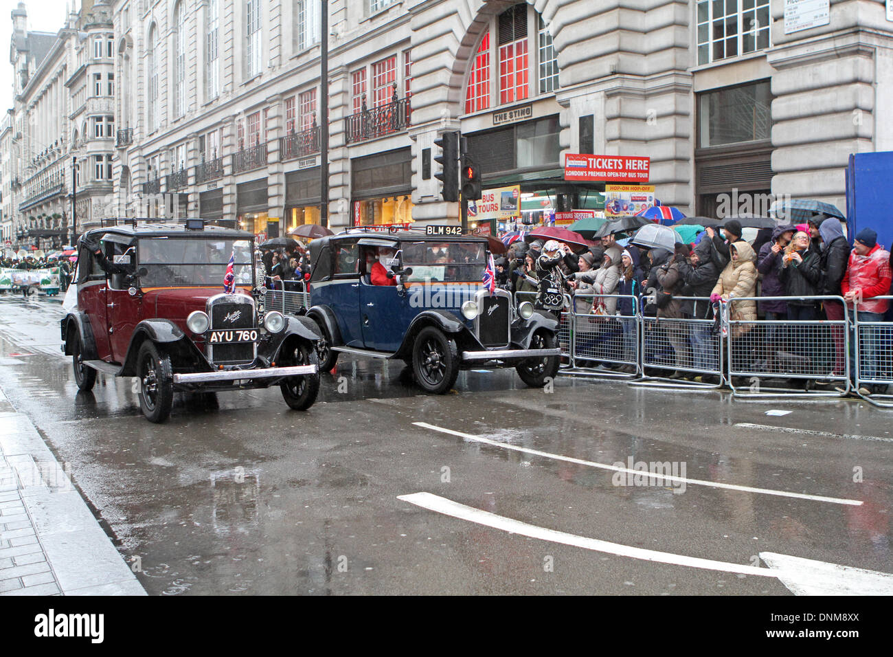 London,UK,1st January 2014,Vintage cars took part in the London's New Year's Day Parade 2014 Credit: Keith Larby/Alamy Live News - Stock Image