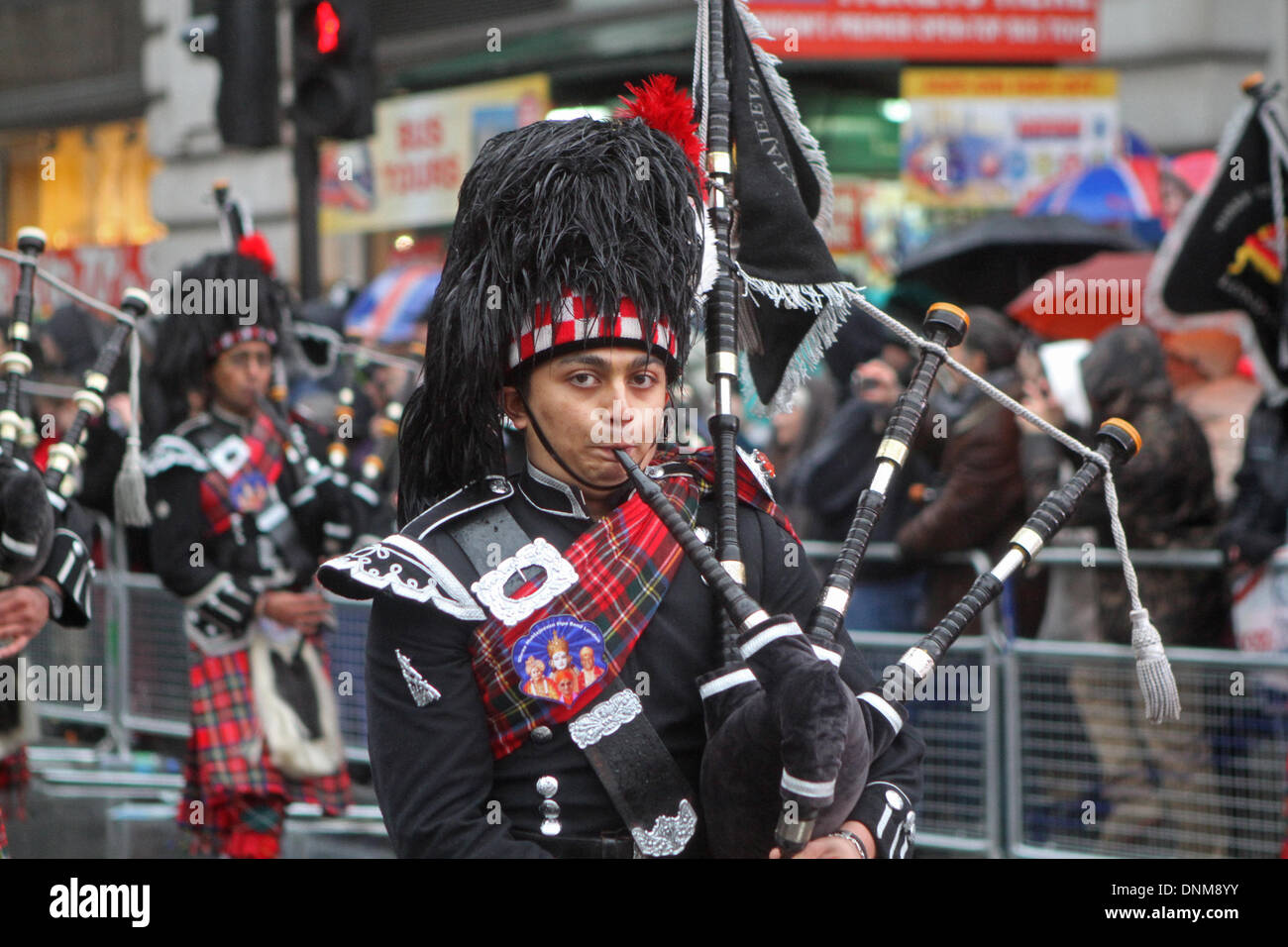 London,UK,1st January 2014,Highland Pipers at the London's New Year's Day Parade 2014 Credit: Keith Larby/Alamy Live News - Stock Image
