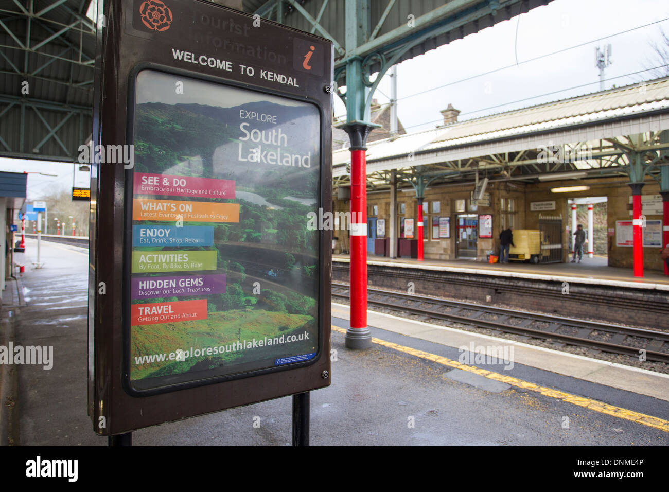 Welcome to Kendal Explore South Lakeland poster at Oxenholme railway station - Stock Image